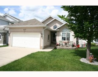 Photo 1: 143 ARBOUR RIDGE Close NW in CALGARY: Arbour Lake Residential Detached Single Family for sale (Calgary)  : MLS®# C3384038