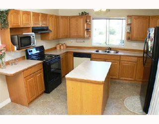 Photo 4: 12350 NIKOLA Street in Pitt_Meadows: Central Meadows House for sale (Pitt Meadows)  : MLS®# V720572