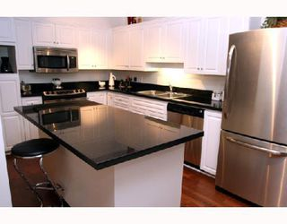 "Photo 1: 202 1118 55TH Street in Tsawwassen: Tsawwassen Central Condo for sale in ""CAMBRIDGE PLACE"" : MLS®# V760577"
