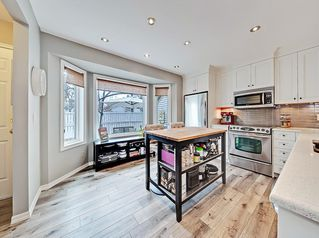 Photo 4: 11 3910 19 Avenue SW in Calgary: Glendale Row/Townhouse for sale : MLS®# C4258186