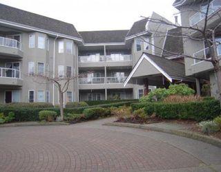 "Photo 1: 209 2020 CEDAR VILLAGE Crescent in North Vancouver: Lynn Valley Condo for sale in ""Kirkstone Gardens"" : MLS®# V812386"