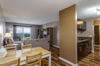 Photo 7: 407 55 ARBOUR GROVE Close NW in Calgary: Arbour Lake Apartment for sale : MLS®# A1015992