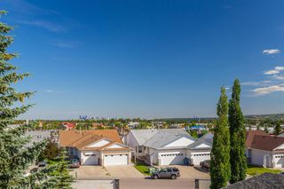 Photo 26: 407 55 ARBOUR GROVE Close NW in Calgary: Arbour Lake Apartment for sale : MLS®# A1015992
