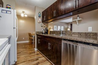 Photo 12: 407 55 ARBOUR GROVE Close NW in Calgary: Arbour Lake Apartment for sale : MLS®# A1015992