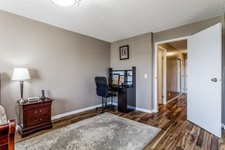 Photo 18: 407 55 ARBOUR GROVE Close NW in Calgary: Arbour Lake Apartment for sale : MLS®# A1015992