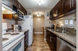 Photo 11: 407 55 ARBOUR GROVE Close NW in Calgary: Arbour Lake Apartment for sale : MLS®# A1015992