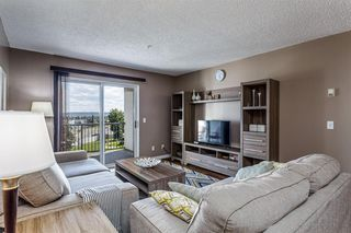Photo 4: 407 55 ARBOUR GROVE Close NW in Calgary: Arbour Lake Apartment for sale : MLS®# A1015992