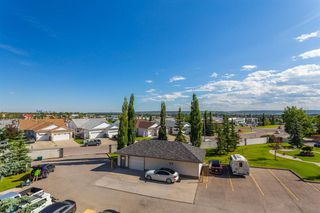 Photo 25: 407 55 ARBOUR GROVE Close NW in Calgary: Arbour Lake Apartment for sale : MLS®# A1015992