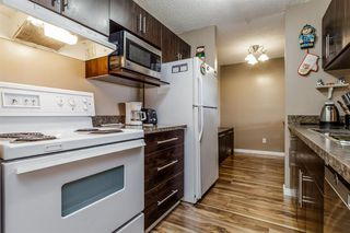 Photo 13: 407 55 ARBOUR GROVE Close NW in Calgary: Arbour Lake Apartment for sale : MLS®# A1015992