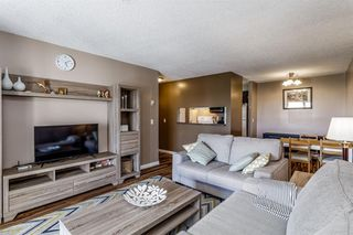 Photo 10: 407 55 ARBOUR GROVE Close NW in Calgary: Arbour Lake Apartment for sale : MLS®# A1015992