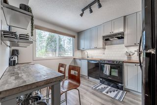 Photo 8: 1512 Ranchlands Way NW in Calgary: Ranchlands Row/Townhouse for sale : MLS®# A1045070