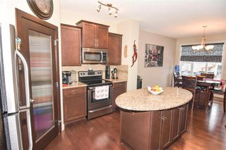 Photo 14: 117 Prairie Springs Crescent SW: Airdrie Detached for sale : MLS®# A1048711