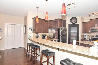 Photo 10: 117 Prairie Springs Crescent SW: Airdrie Detached for sale : MLS®# A1048711