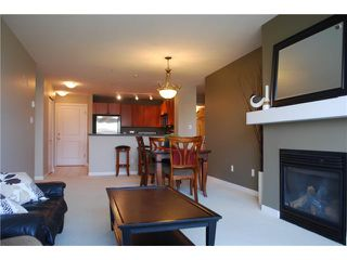 """Photo 2: 313 7089 MONT ROYAL Square in Vancouver: Champlain Heights Condo for sale in """"CHAMPLAIN VILLAGE"""" (Vancouver East)  : MLS®# V838473"""