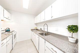 "Photo 4: 105 10221 133A Street in Surrey: Whalley Condo for sale in ""Village at Surrey Place"" (North Surrey)  : MLS®# R2528309"
