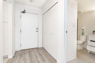 "Photo 2: 105 10221 133A Street in Surrey: Whalley Condo for sale in ""Village at Surrey Place"" (North Surrey)  : MLS®# R2528309"