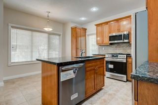 Photo 4: 4111 GARRISON Boulevard SW in Calgary: Garrison Woods Row/Townhouse for sale : MLS®# C4300161