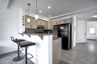 Photo 7: 7 Country Village Villas NE in Calgary: Country Hills Village Row/Townhouse for sale : MLS®# A1012600