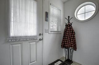 Photo 3: 7 Country Village Villas NE in Calgary: Country Hills Village Row/Townhouse for sale : MLS®# A1012600