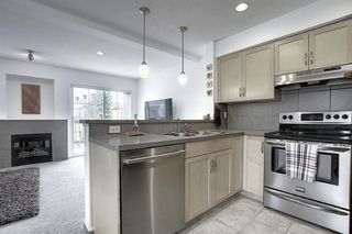 Photo 5: 7 Country Village Villas NE in Calgary: Country Hills Village Row/Townhouse for sale : MLS®# A1012600