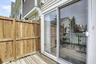 Photo 11: 7 Country Village Villas NE in Calgary: Country Hills Village Row/Townhouse for sale : MLS®# A1012600