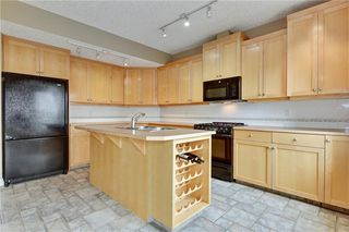 Photo 12: 2259 FLANDERS Avenue SW in Calgary: Garrison Woods Row/Townhouse for sale : MLS®# A1035843