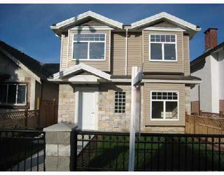 Main Photo: 4575 VICTORIA Drive in Vancouver: Victoria VE House 1/2 Duplex for sale (Vancouver East)  : MLS®# V761767