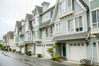 "Photo 1: 24 16388 85 Avenue in Surrey: Fleetwood Tynehead Townhouse for sale in ""Camelot Village"" : MLS®# R2400032"