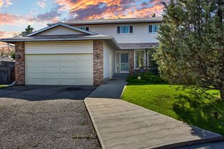 Main Photo: 124 WOODSIDE Bay SW in Calgary: Woodlands Detached for sale : MLS®# A1011131