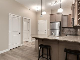 Photo 12: 423 35 ASPENMONT Heights SW in Calgary: Aspen Woods Apartment for sale : MLS®# A1057146