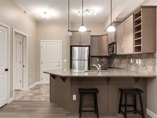 Photo 11: 423 35 ASPENMONT Heights SW in Calgary: Aspen Woods Apartment for sale : MLS®# A1057146