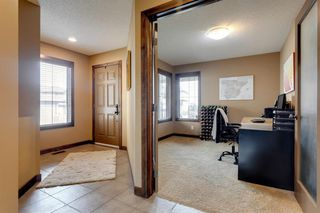 Photo 2: 123 Tremblant Way SW in Calgary: Springbank Hill Detached for sale : MLS®# A1022174