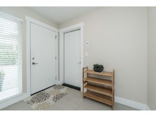 "Photo 5: 102 218 BEGIN Street in Coquitlam: Maillardville Townhouse for sale in ""Begin Square"" : MLS®# R2504206"