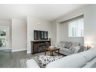 "Photo 7: 102 218 BEGIN Street in Coquitlam: Maillardville Townhouse for sale in ""Begin Square"" : MLS®# R2504206"