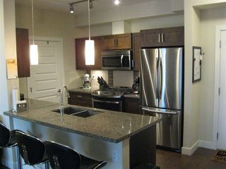"""Photo 5: 301 20078 FRASER Highway in Langley: Langley City Condo for sale in """"Varsity"""" : MLS®# R2510892"""