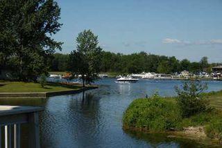 Photo 1: 23 100 Laguna Parkway in Lagoon City: Condo for sale (X17: ANTEN MILLS)  : MLS®# X1768918