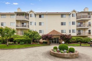 "Photo 1: 207 22611 116 Avenue in Maple Ridge: East Central Condo for sale in ""ROSEWOOD COURT"" : MLS®# R2468837"