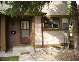 Photo 1: 595 Adsum Drive in WINNIPEG: Maples / Tyndall Park Condominium for sale (North West Winnipeg)  : MLS®# 2918299