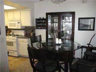 Photo 7: RANCHO PENASQUITOS Condo for sale : 2 bedrooms : 9439 Fairgrove #203 in San Diego