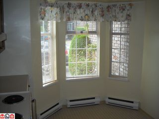 """Photo 3: 144 12233 92 Avenue in Surrey: Queen Mary Park Surrey Townhouse for sale in """"Orchard Lake"""" : MLS®# F1021469"""