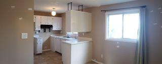 Photo 6: 10317 172 Avenue in Edmonton: Zone 27 House Half Duplex for sale : MLS®# E4169498