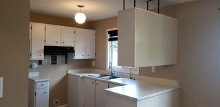 Photo 4: 10317 172 Avenue in Edmonton: Zone 27 House Half Duplex for sale : MLS®# E4169498