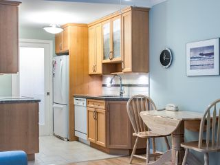 """Photo 7: 215 555 W 14TH Avenue in Vancouver: Fairview VW Condo for sale in """"Cambridge Place"""" (Vancouver West)  : MLS®# R2470013"""