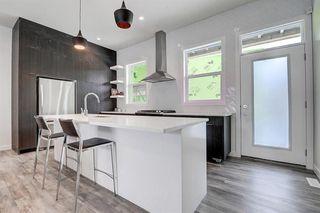 Photo 10: 452 15 Avenue NE in Calgary: Renfrew Row/Townhouse for sale : MLS®# A1024960
