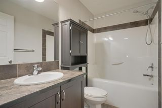 Photo 17: 48 Arbours Circle NW: Langdon Row/Townhouse for sale : MLS®# A1045296