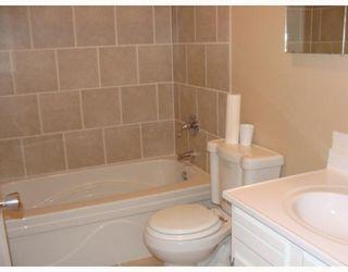 Photo 11: 203 PENMEADOWS Close SE in CALGARY: Penbrooke Residential Detached Single Family for sale (Calgary)  : MLS®# C3403189