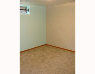Photo 18: 203 PENMEADOWS Close SE in CALGARY: Penbrooke Residential Detached Single Family for sale (Calgary)  : MLS®# C3403189
