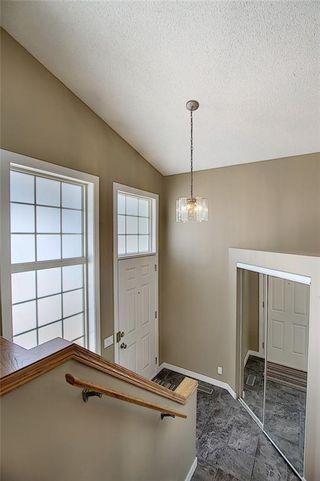 Photo 5: 159 HIDDEN GR NW in Calgary: Hidden Valley House for sale : MLS®# C4293716