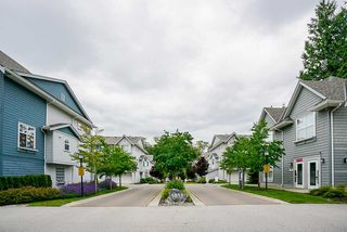 "Photo 1: 70 5858 142 Street in Surrey: Sullivan Station Townhouse for sale in ""Brooklyn Village"" : MLS®# R2479598"