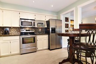 "Photo 6: 202 33090 GEORGE FERGUSON Way in Abbotsford: Central Abbotsford Condo for sale in ""TIFFANY PLACE"" : MLS®# R2413413"